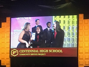 Centennial High School students Makaila Susi and Kathleen Early appear on the big screen at the Future Business Leaders of America national conference in Anaheim as they are named national champions for Community Service Project.