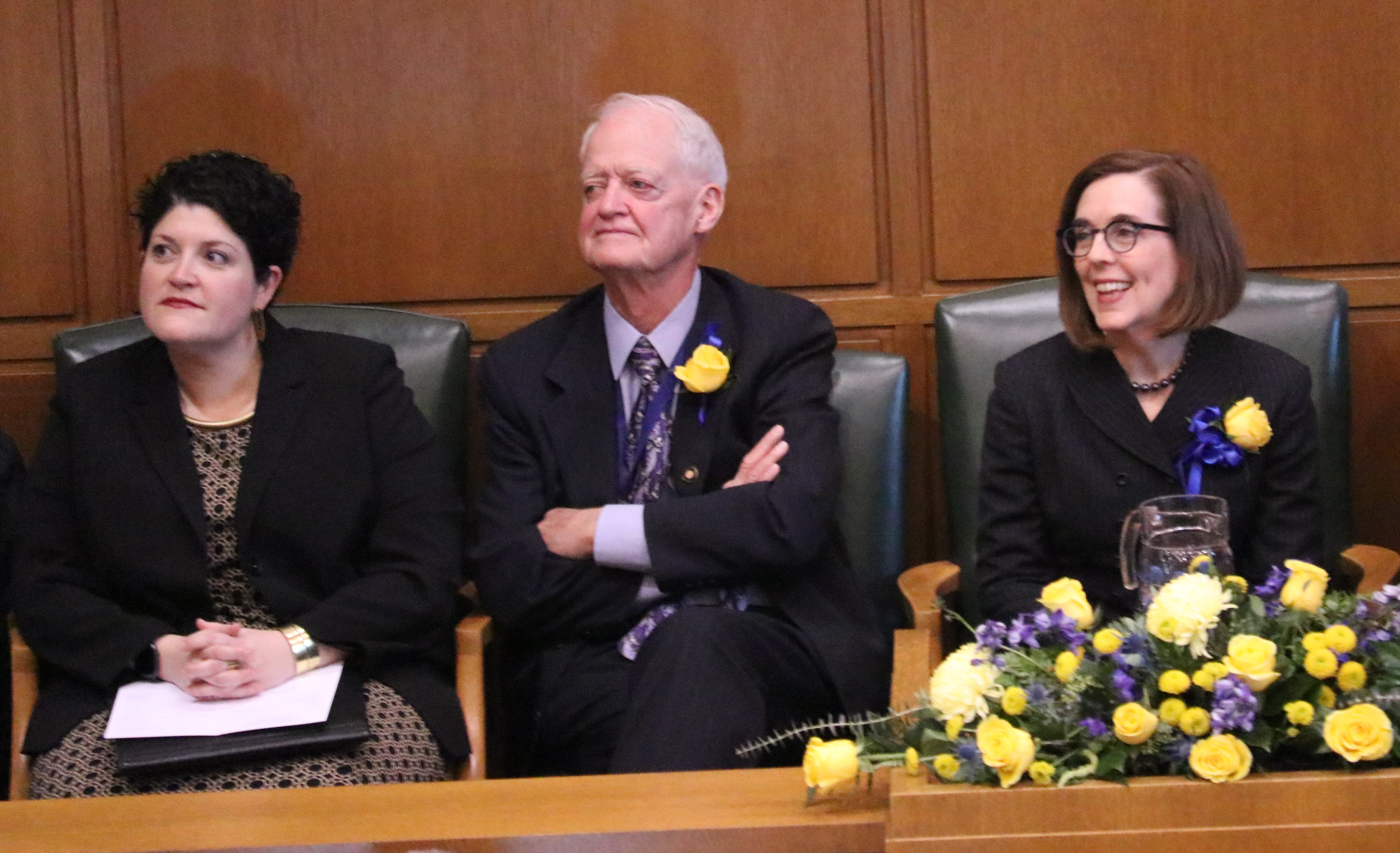 Rabbi Rachel Joseph (left) sat with Senate President Peter Courtney and Gov. Kate Brown before offering the invocation for Brown's oath of office ceremony Monday in the Oregon House chamber. (Photo by Jake Arnold, OSBA)