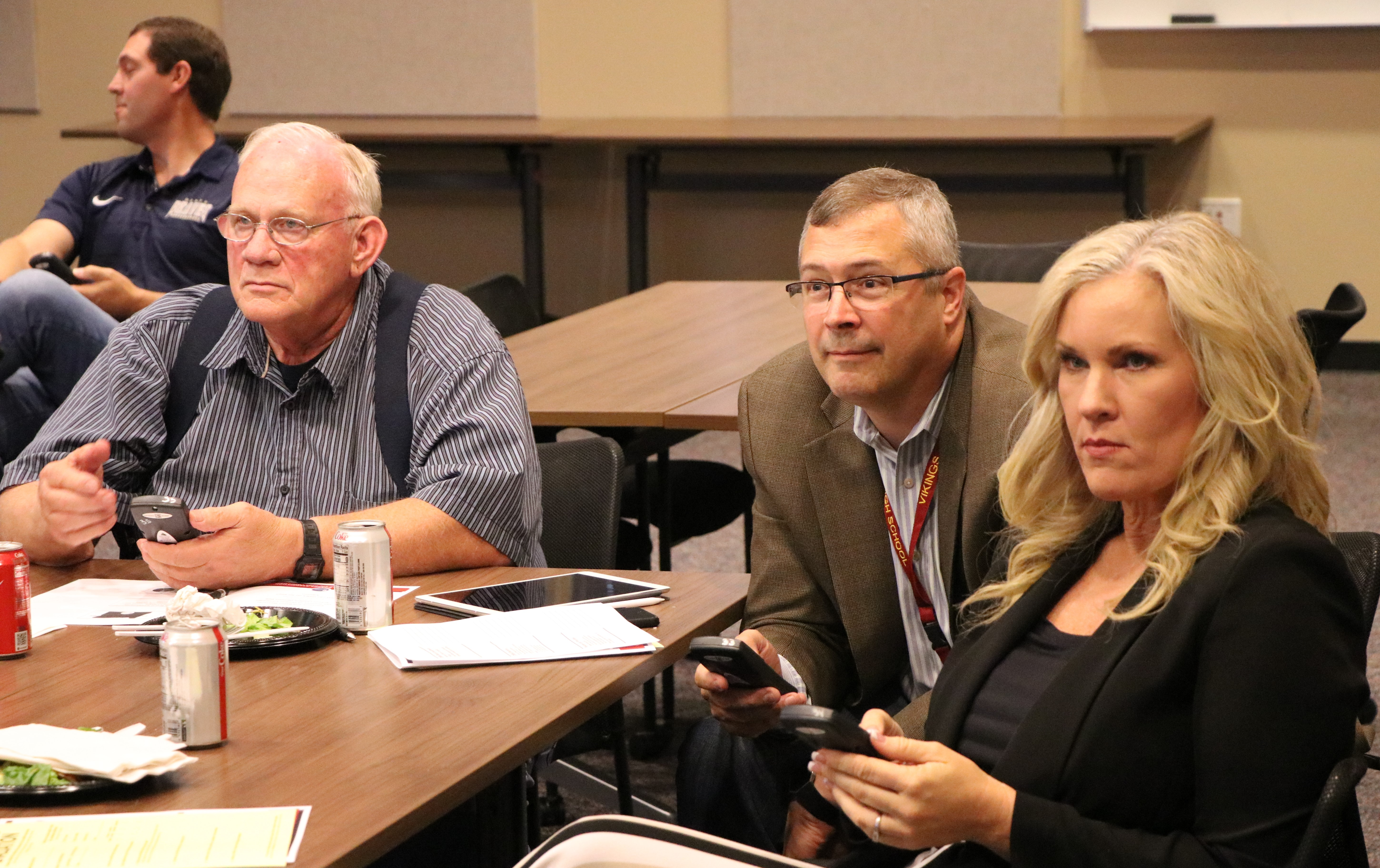 Forest Grove School Board member Fred Marble, Forest Grove Superintendent David Parker and Sherwood Superintendent Heather Cordie participate in polling at the Fall Regional meeting in Hillsboro.