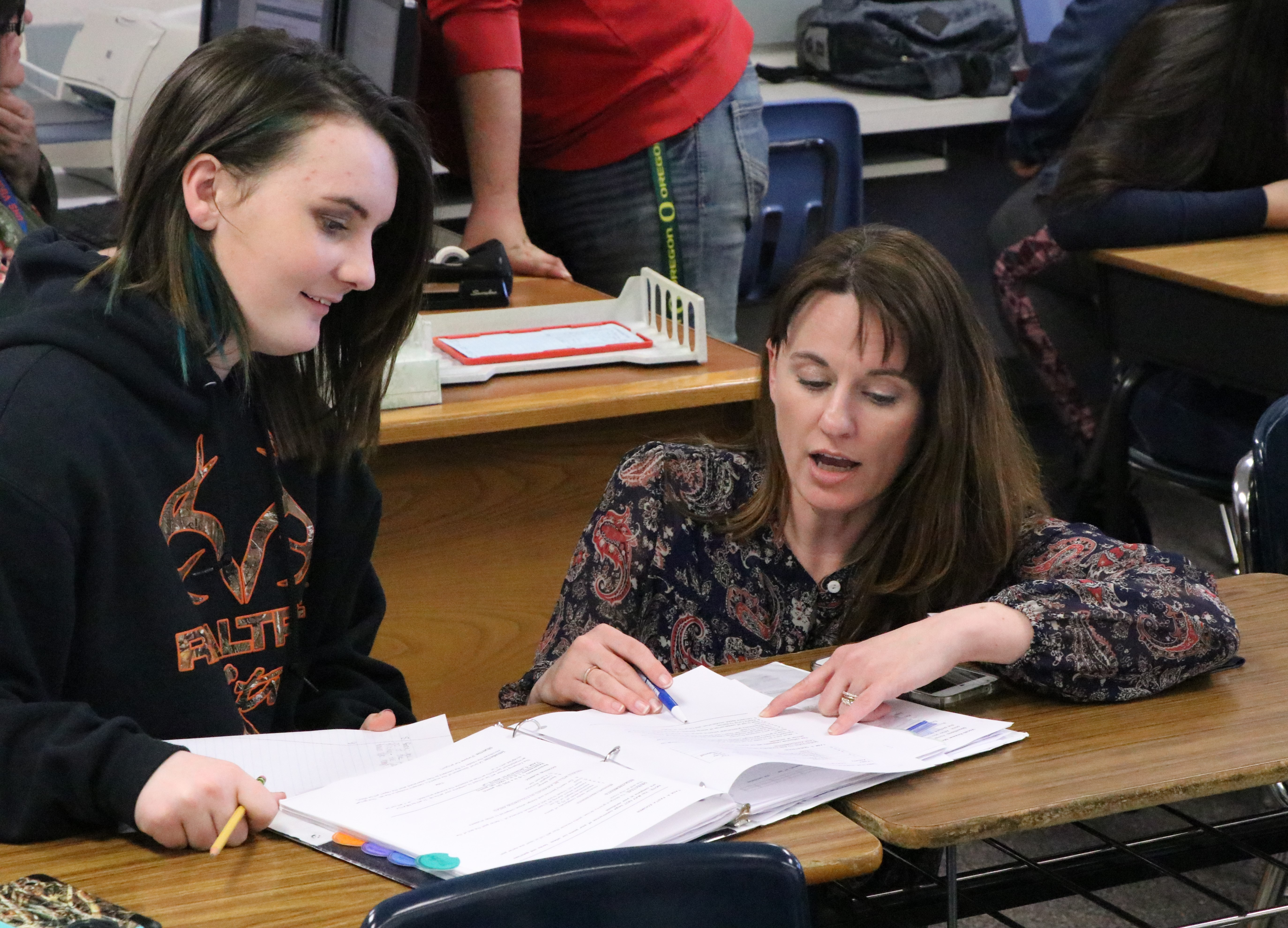 A student asks Umatilla Superintendent Heidi Sipe for help.