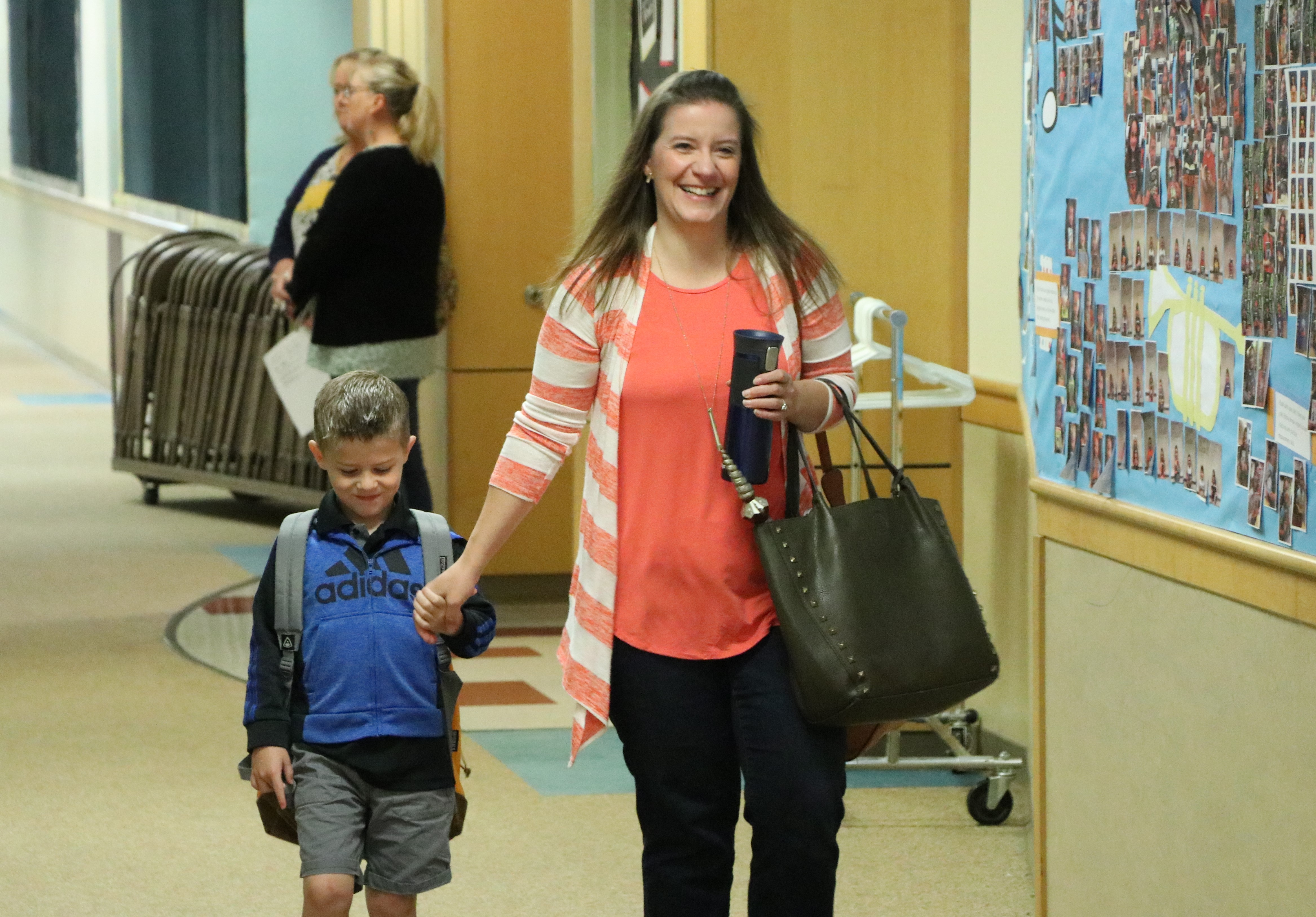 Natalie Frederick walks her son Lucas to kindergarten at Corbett Elementary.