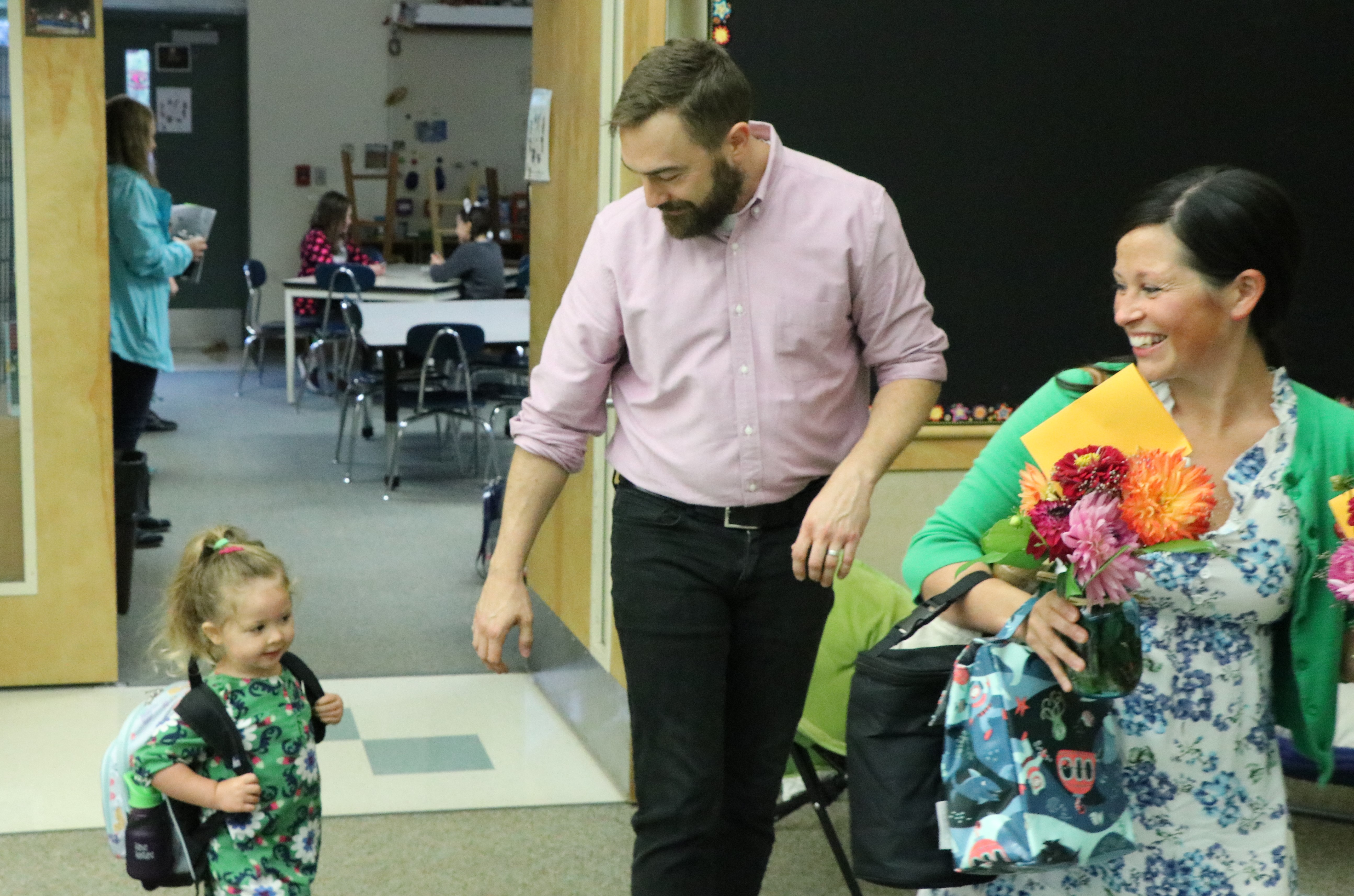 Corbett teachers Marleen and Sam Wallace escort their daughter Esmerelda to preschool on orientation day.