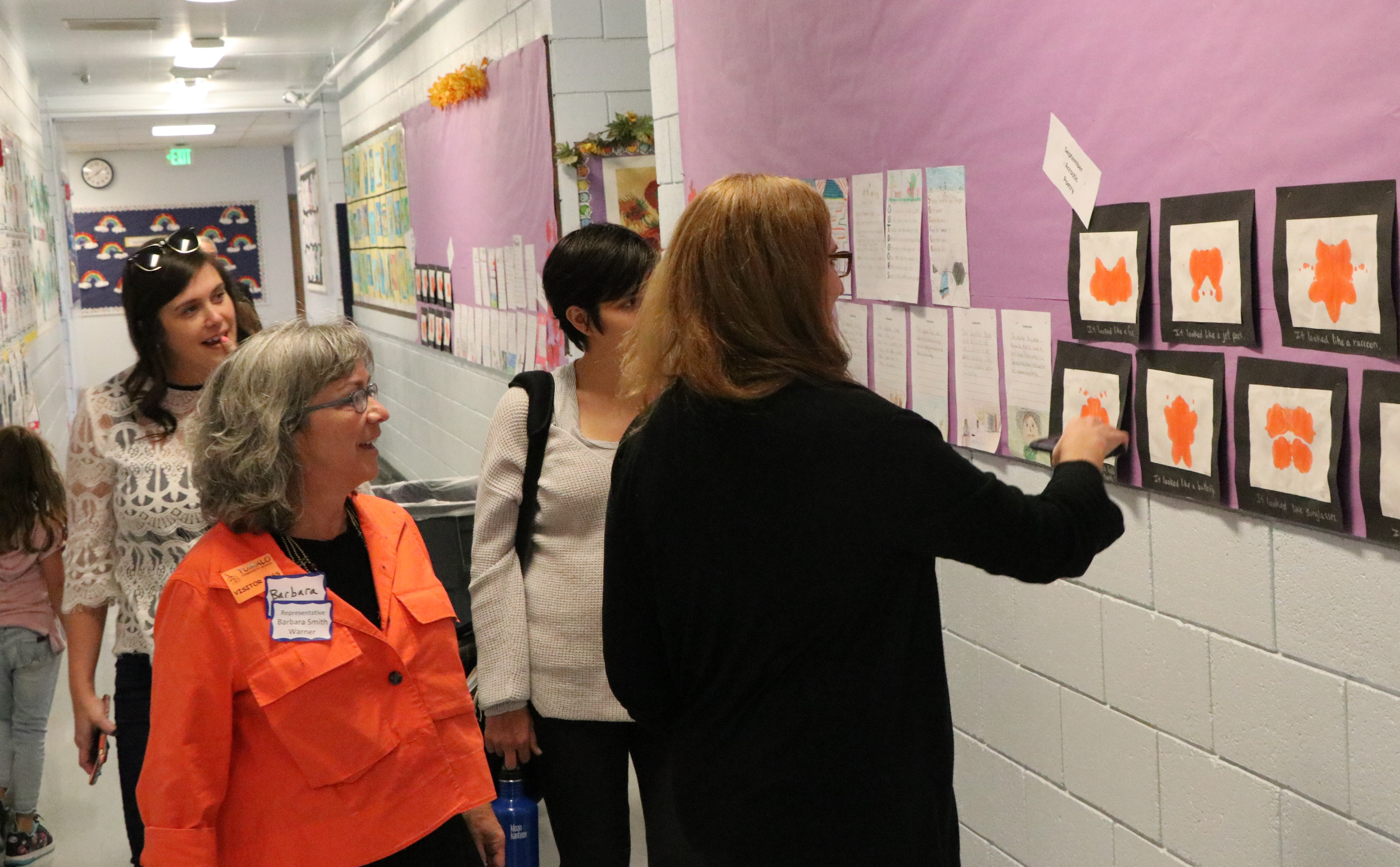 Rep. Barbara Smith Warner, D-Portland, and Rep. Julie Fahey, D-Eugene, admire student art during a tour of Tumalo Community School.