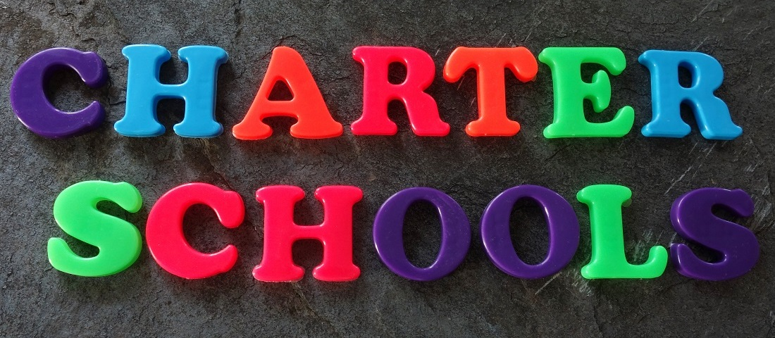 "letter magnets spell ""charter schools"""