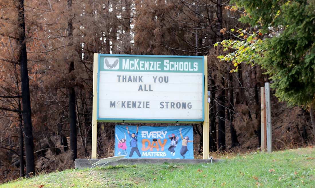 "McKenzie School District sign that reads ""Thank You All - McKenzie Strong"""