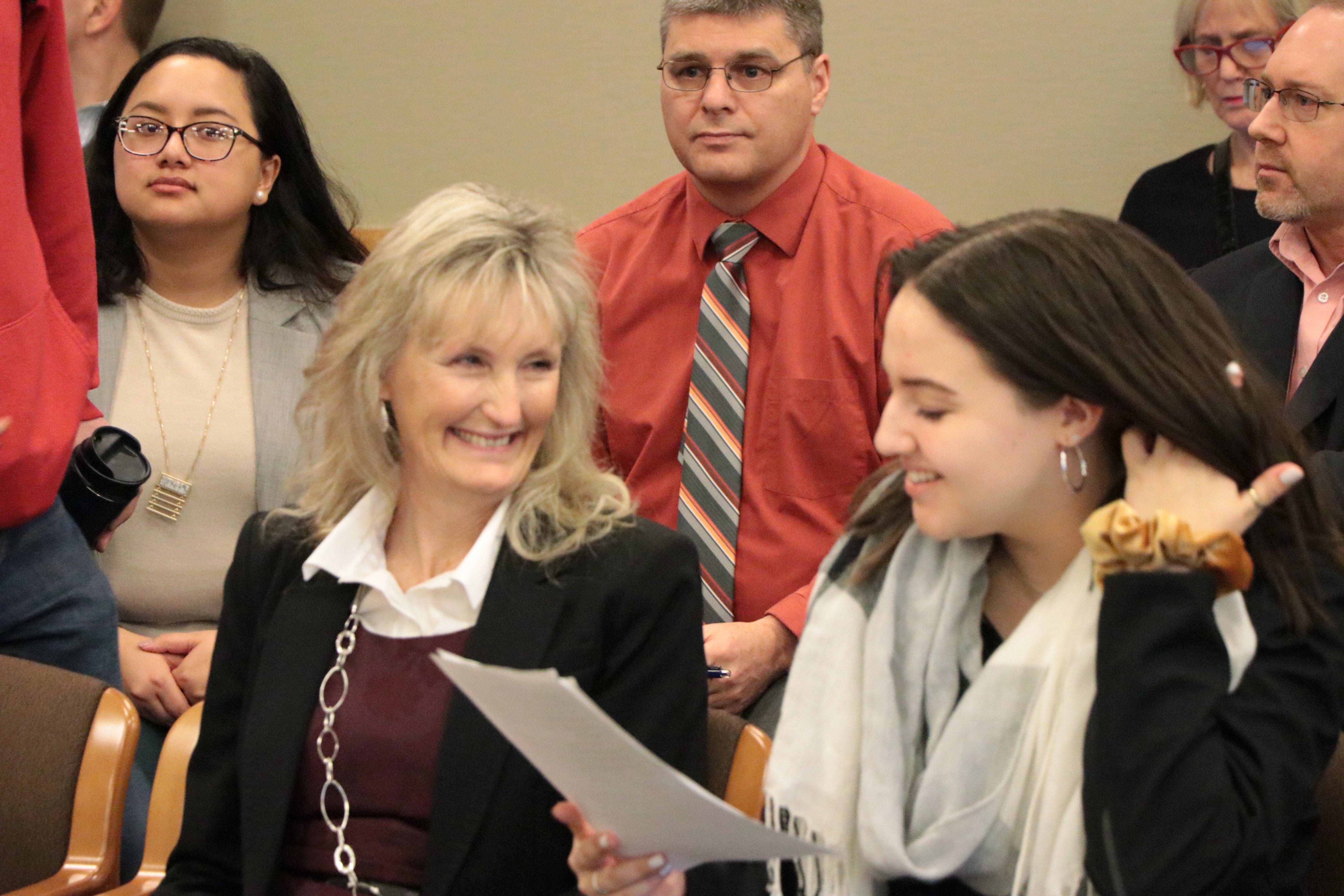 OSBA Past President LeeAnn Larsen, left, and Jessica Jose-Nickerson, a Century High junior and advisory member of the Hillsboro School Board, visit before testifying Thursday.