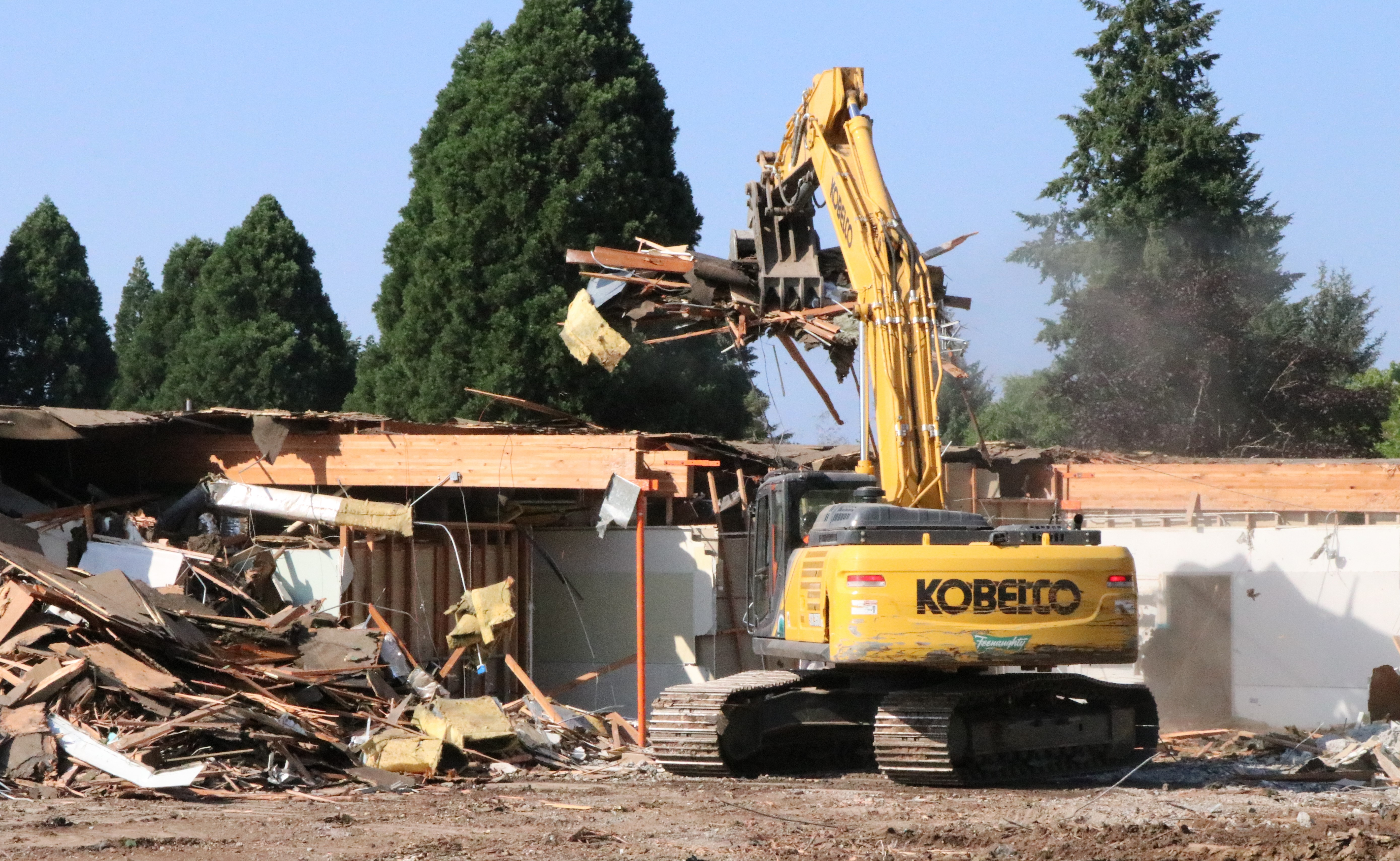 An excavator tears down a wing of the James Templeton Elementary School.