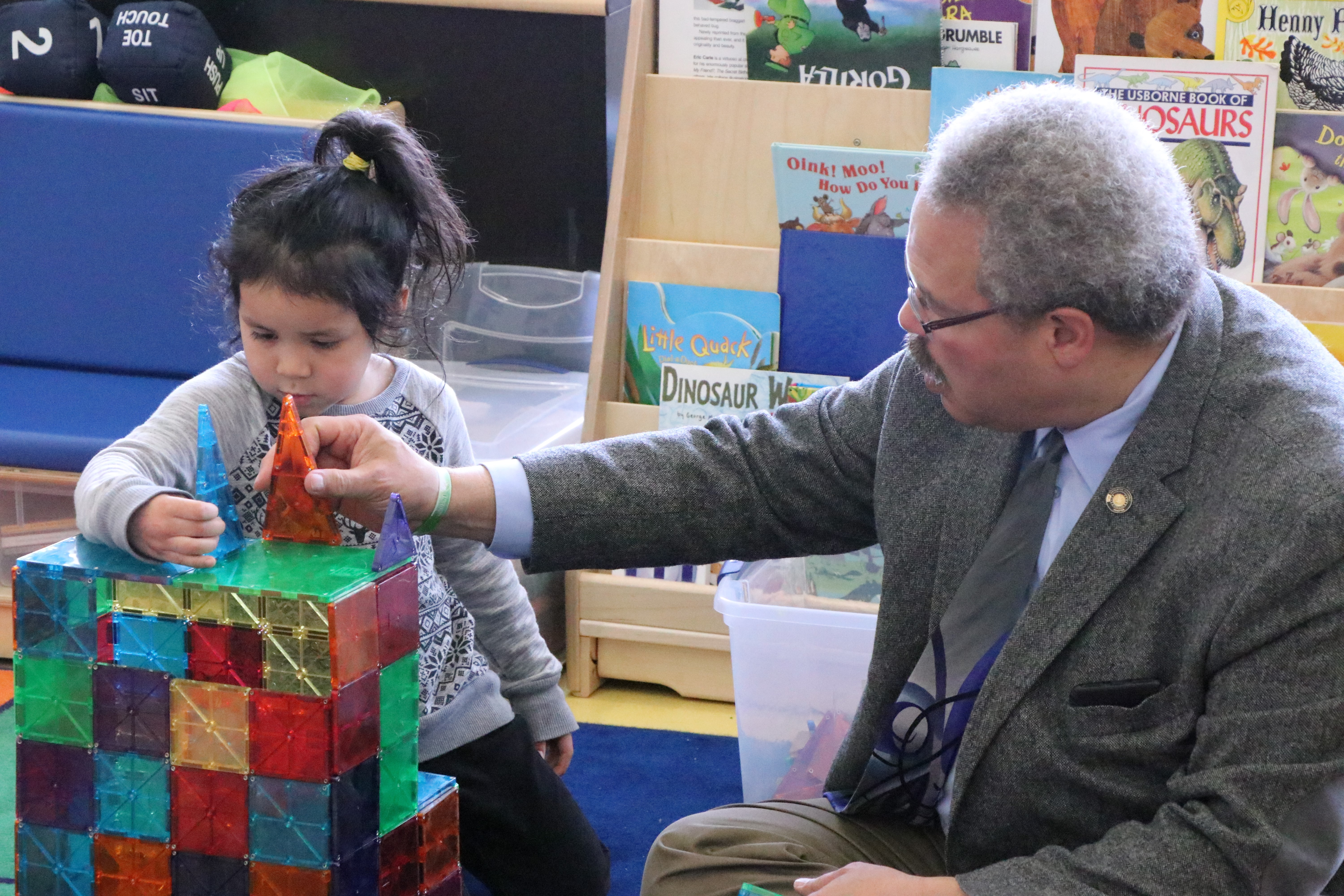 Sen. Lew Frederick checks out an early learning program at Maple Elementary.